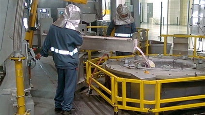 men at work in aluminium melting / pouring  department